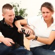 Young couple emotionally playing video games - Stockfoto