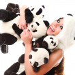 Woman in panda suit with little pandas - Stock Photo