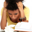 Young black woman tired from studying — Stock Photo #17882375
