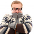 Stock Photo: Guy in sweater feel cold over a white background
