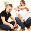 Stock Photo: Young couple emotionally playing video games