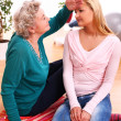 Granny caring about her granddaughter health - Stock Photo