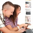 Two young get leisure with laptop at home — Stock Photo