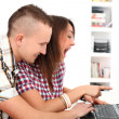 Two young get leisure with laptop at home — Stock Photo #17882975