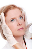 Close up of woman face and doctor gloves — Stock Photo