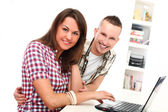 Two young get leisure with laptop at home — Stockfoto