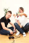 Young couple emotionally playing video games — Stock Photo