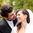 Beautiful bride and happy groom in autumn park — Lizenzfreies Foto
