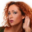Beautiful redhead womlistening gesture — Stock Photo #18078475