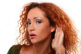 Beautiful redhead woman listening gesture — Stock Photo