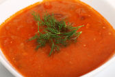 Top view of bowl of hot red soup isolated — Stock Photo