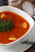 Image of bowl of hot red soup served — Stock Photo