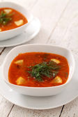 Image of bowls of hot red soup isolated on table — Stock Photo
