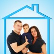 Beautiful caucasian couple with baby in a house — Stock Photo
