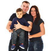Beautiful caucasian couple with baby isolated — Stock Photo
