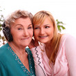 Happy elderly woman with granddaughter - Stock Photo