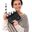 Young happy woman holding a clapboard - Stok fotoraf