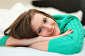 Young beautiful girl in bedroom — Stock Photo