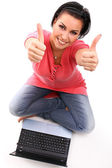 Young happy woman with laptop — Stock Photo
