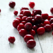 Fresh cranberries on a white table - Stock Photo