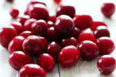 Fresh cranberries on a white table — Stock Photo