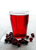 Cranberry juice and berries — Stock Photo
