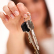 Beautiful woman holds keys - Stock Photo