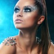 Portrait of woman with artistic make-up — Stock Photo