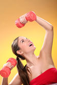 Beautiful woman with dumbbells — Stock Photo