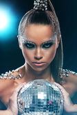 Woman with artistic make-up and discoball — Stock Photo