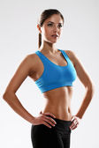 Young beautiful woman in fitness wear — Stock Photo