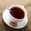 White cup of tea on a natural tablecloth — Stock Photo