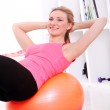 Young woman working out with fitball — Stock Photo