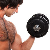 Closeup image of young man with dumbbell — Stock Photo