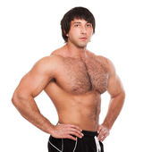 Attractive muscular guy isolated — Stock Photo