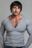 Attractive muscular guy in casual — Stock Photo