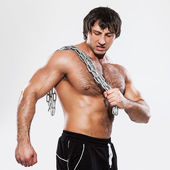 Agressive bodybuilder with chain — Stock Photo