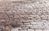 Sidewalk with old stones — Stock Photo