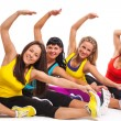 Stock Photo: Group of women exercising over background