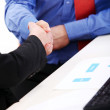 Businesspeople handshake at office — Stock Photo