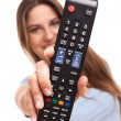Attractive caucasian woman with  TV remote — Stock Photo