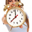 Young caucasian woman with alarm clock — Stock Photo