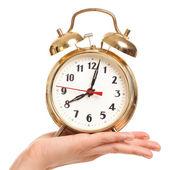 Alarm clock in woman's hand — Foto de Stock