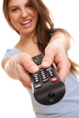 Attractive caucasian woman with TV remote — Stok fotoğraf