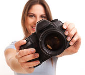 Young caucasian woman with camera — Stock Photo