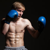 Young handsome boxer in a movement — Foto de Stock