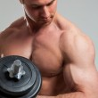 Young bodybuilder with barbell — Stock Photo