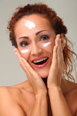 Beautiful woman with cream on face — Stock Photo
