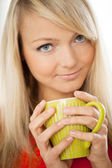 Young attractive woman with cup — Stock Photo