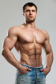 Handsome muscular guy with naked torso — Stock Photo